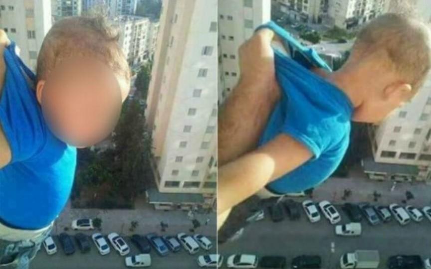 Un tată și-a ținut copilul atârnat la etajul al 15-lea pentru a face o fotografie pe Facebook