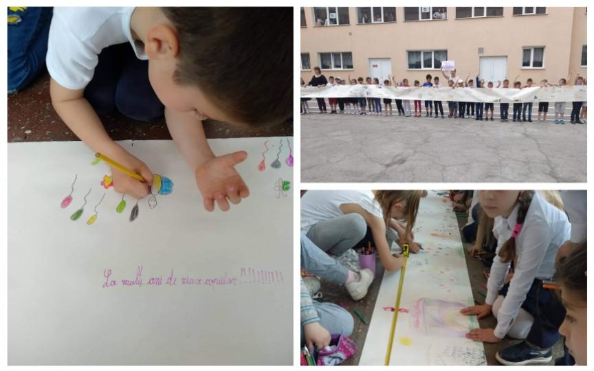 (FOTO) 130 de elevi din clasa I din capitală au făcut cea mai mare felicitare de Ziua copiilor