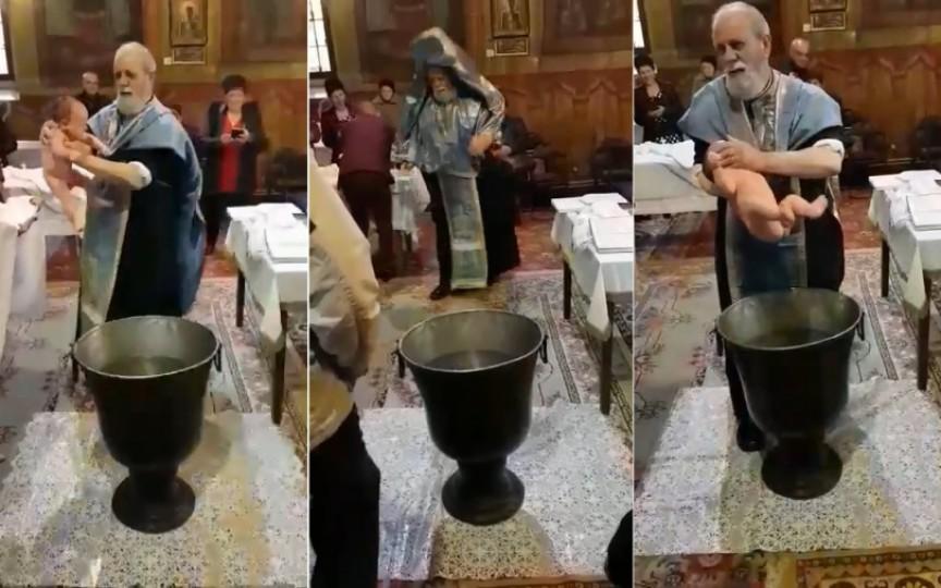 (VIDEO) Botez de groază! Un preot nervos a început a zdruncina bebeluşul care plângea speriat