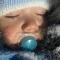 Fotografia care face înconjurul internetului! Copii surprinși dormind afară, în paturi, la 0 grade Celsius